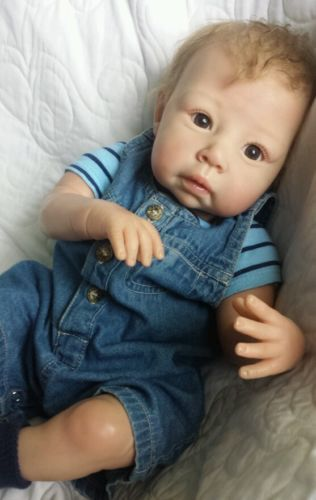 Love his overalls! I want overalls 4 my babies, but can't find any round here.