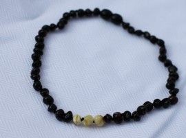 This little amber necklace is a little bit different to the average amber teething necklace with its sufer dude colouring. Baltic Amber Teething Necklace - Surfer Dude. Found at Not Another Baby Shop