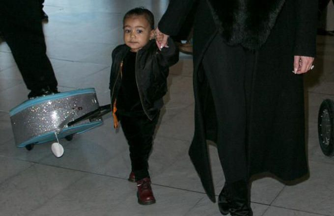 Here's a Video of North West Gliding Through the Airport on Her 'Frozen' Suitcase