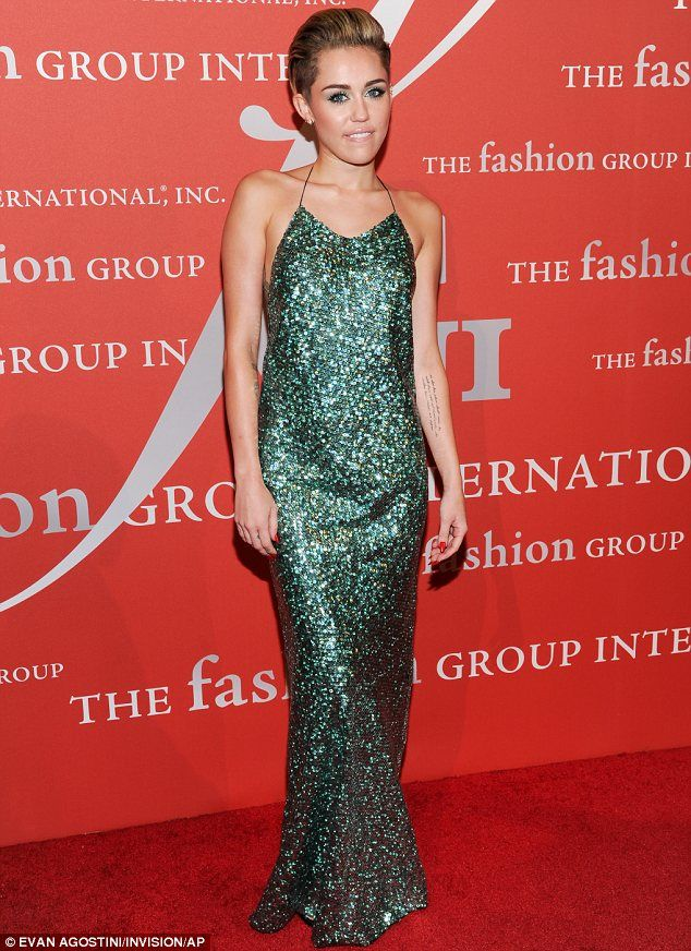 10-21-13.    So she can do demure: Miley Cyrus looked elegant at the Fashion Group International's Night Of Stars gala - AMAZING!!!