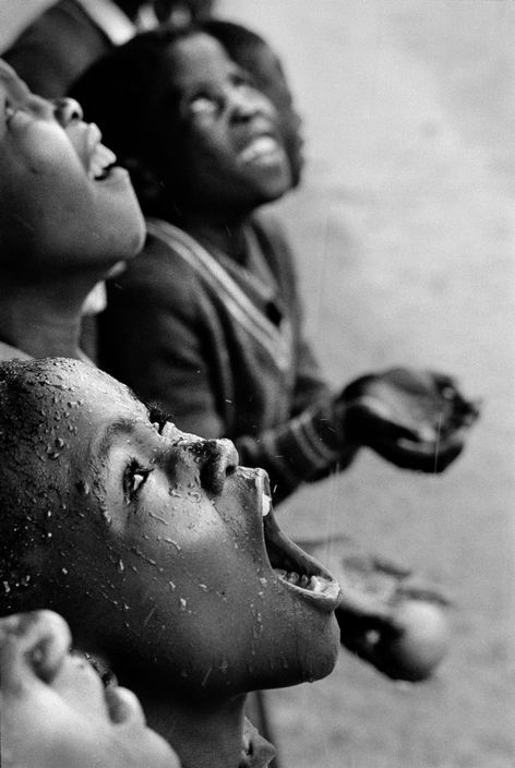 School children in rain storm. Lesotho, South Africa (1981) ~ by Chris Steele-Perkins | Magnum Photos