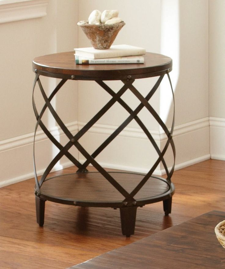steve silver winston round distressed tobacco wood and metal end table the steve silver winston round distressed tobacco wood and metal end table features
