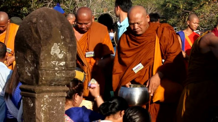 Buddhist alms giving ceremony. Giving alms to monks was the most popular activities for buddhist, Wat Phu Festival Day on 11 February 2017, UNESCO world heritage site in Champasak, Southern Laos