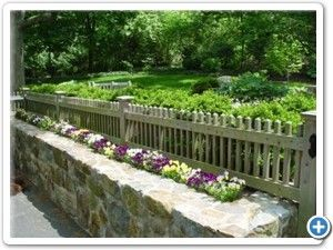 Another stone wall topped with pickets. I like the planter idea also.