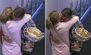 Swiss champion Roger Federer was greeted by wife Mirka in the aftermath of his Australian Open victory over Rafael Nadal, with the couple's embrace a clear sign just how much the win meant.