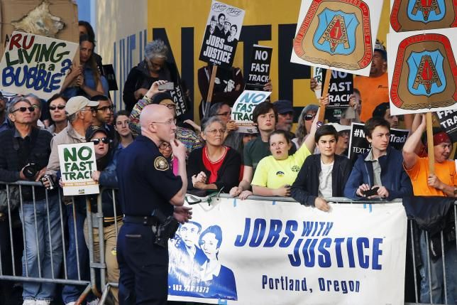 Senate Democrats gang up to delay fast-track trade bill Protesters, many against the so-called fast track trade authority of the Trans-Pacific Partnership (TPP) trade agreement, rally outside the hotel where U.S. President Barack Obama is participating in a Democratic National Committee (DNC) event in Portland, Oregon May 7, 2015. REUTERS/Jonathan Ernst