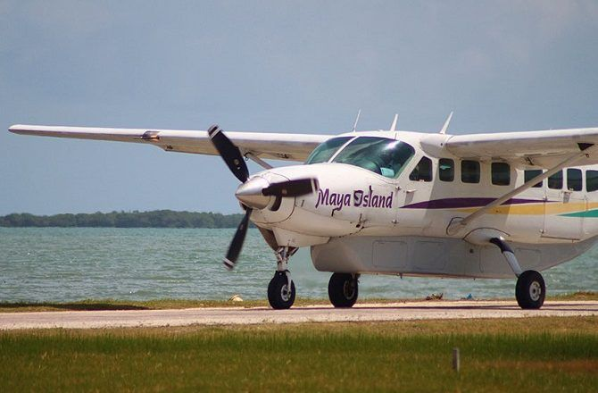 A Maya Island Air plane on the runway