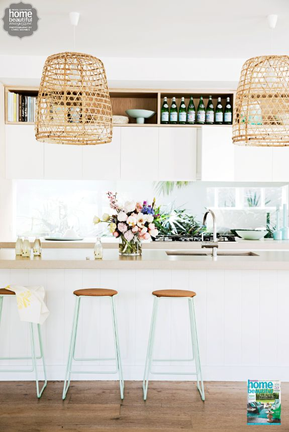 Mint green stools make a sweet statement in this white and bright kitchen