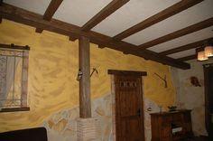Aprende los pasos para instalar vigas falsas de imitación a madera