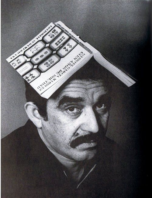 "Gabriel Garcia Marquez with ""One Hundred Years of Solitude"" on his head."