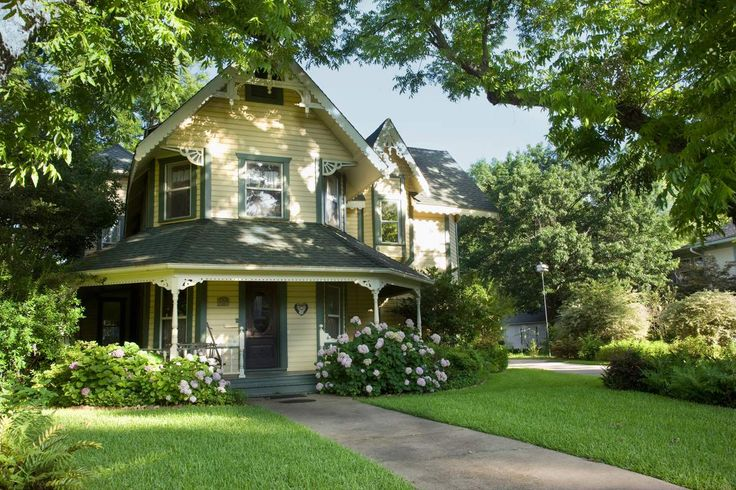 yellow victorian style house