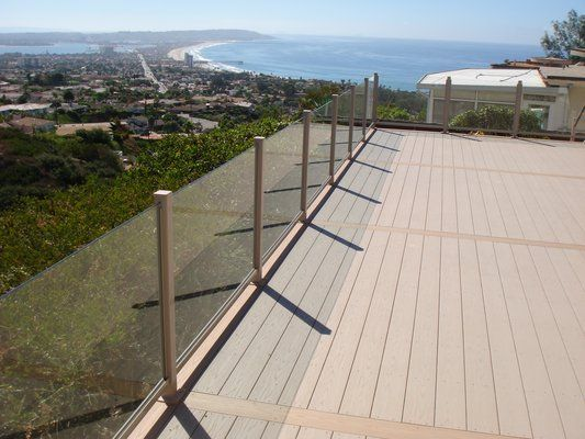 Glass panel no top rail loft pinterest railings for for Garden decking glass panels