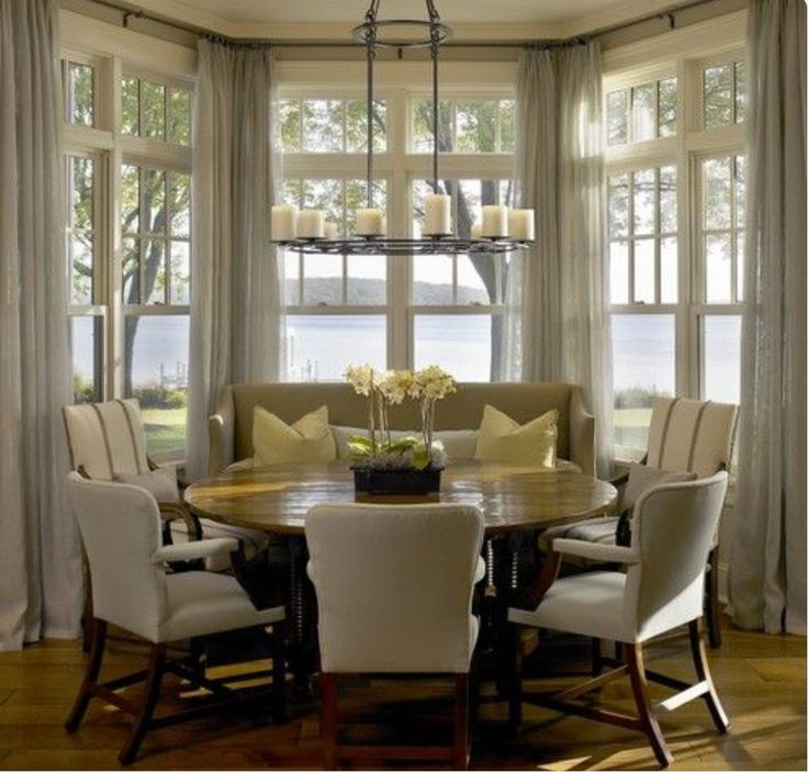 love this dinning room in kitchen setup breakfast nook drapes in bay window and round table with enough seats for our family