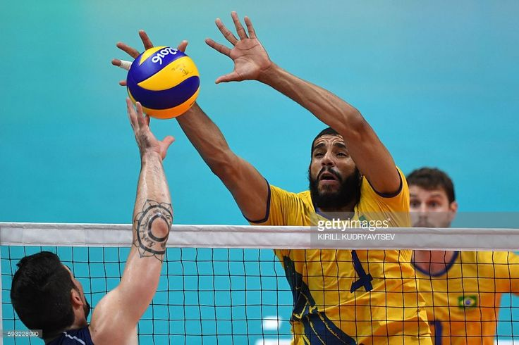 Brazil's Wallace Leandro De Souza jumps up to block the ball during the men's…