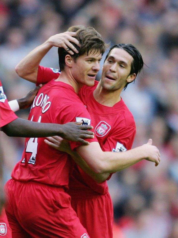 Legends Xavi Alonso and Luis Garcia