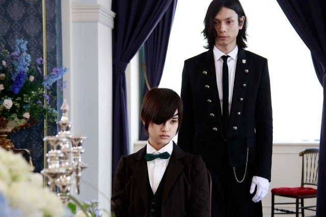 Production stills have been released for upcoming live-action adaptation of Black Butler.  The pictures feature Ayame Goriki as Shiori Genpo—a female descendent of the Phantomhive family in the year 2020 who poses as a male to act as heir—and Hiro Mizushima as her flawless demon butler, Sebastian Michealis.