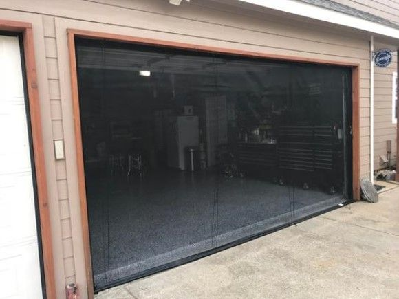 Exterior View Of A Open Garage With A Garage Door Screen Retractable Screen Door Building A New Home Garage Doors