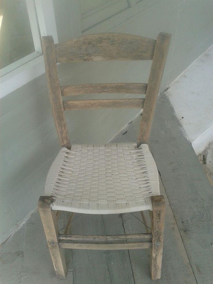Handmade knitted rope bottom chair.