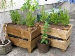 Home made garden containers painted or stained planted up with summer salad vegetables or summer bedding plants will bighten any patio or balcony.