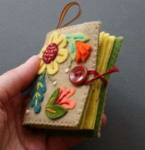 Felt needle book - lovely construction, and the cover pieces can be modified to any design/period.