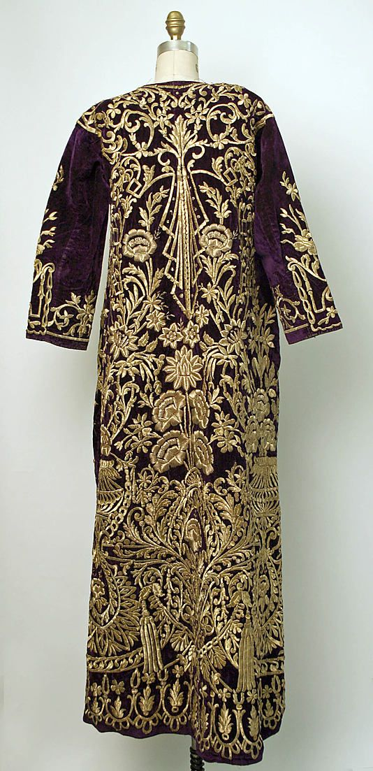The back of a 'bindallı entari' (traditional bridal / festive woman's dress). Adorned with goldwork in 'sarma' / 'Maraş işi' technique. The larger segments are raised, by working the goldwork embroidery over a card (board) foundation. Late-Ottoman, urban, circa 1850. (Metropolitan Museum of Art, New York).