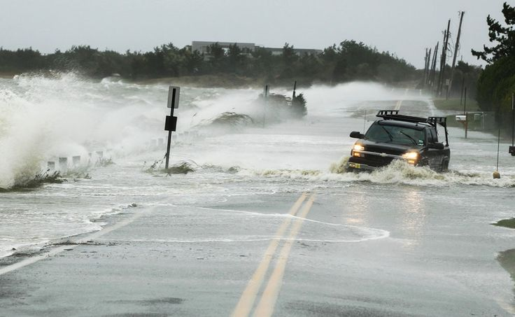 A truck drives through water pushed over a road by Hurricane Sandy in Southampton, New York, on October 29, 2012. Hurricane Sandy, the monster storm bearing down on the East Coast, strengthened on Monday after hundreds of thousands moved to higher ground, public transport shut down and the stock market suffered its first weather-related closure in 27 years. (Reuters/Lucas Jackson)
