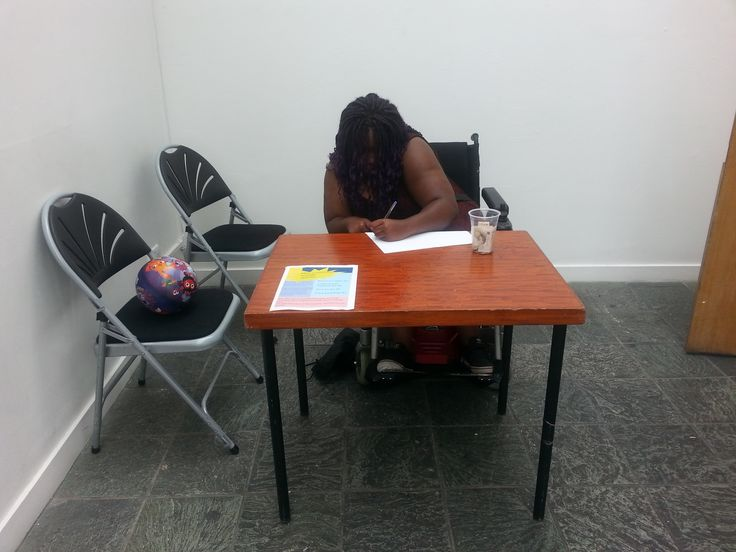 One of the participants preparing to greet people at her team's event.