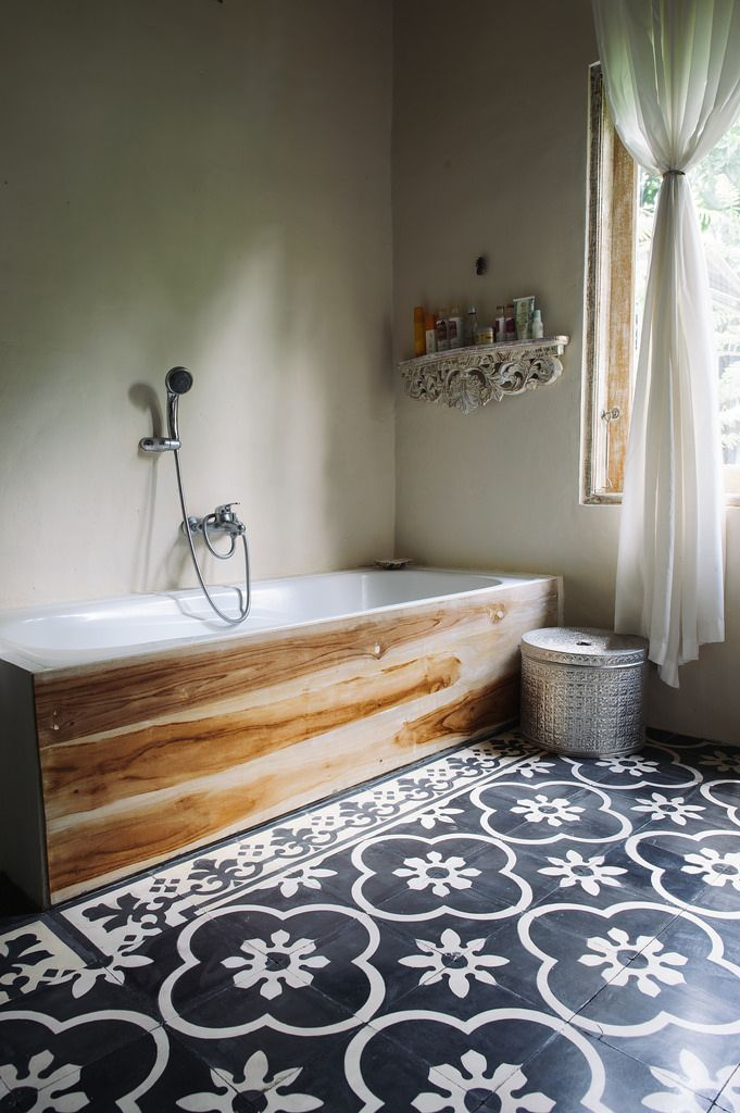 This bathroom is in Bali, so I assume that is teak around the tub (and gorgeous tile!!) love this.