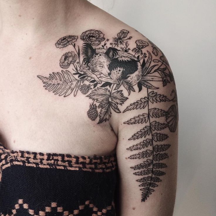 my tattoo of my mini Australian shepherd Nola nested amongst ferns, ranunculus, Queen Anne's lace, salmonberry, fireweed, and nasturtium by Pony Reinhardt at Tenderfoot Studios in Portland, Oregon.