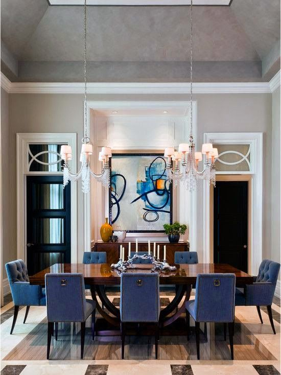 Modern dining room with blue chairs