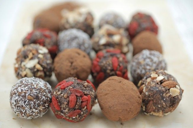330 g raw whole almonds  60g  Healthy Chef Pure Native WPI or Organic Pea Protein  16 fresh dates, pitted  2 tablespoons cocoa powder  1 tablespoon natural vanilla extract  1/2 teaspoon ground  cinnamon  coconut, goji berry, cacao, nuts for rolling