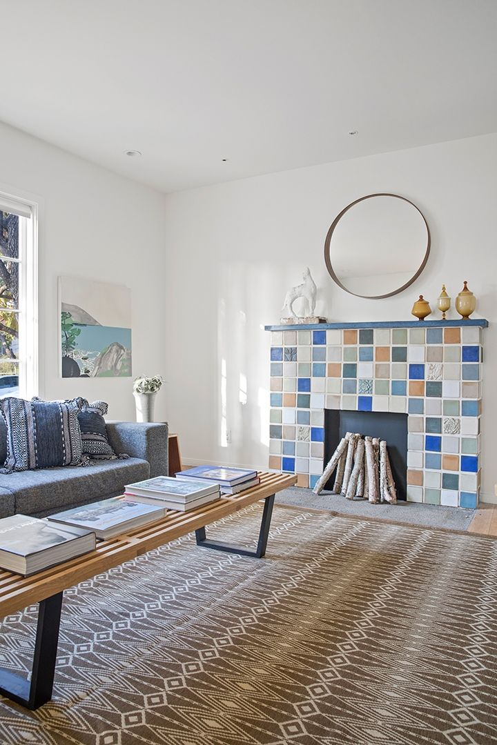 """Recently restored by the home improvement guru, this airy abode dating back to 1927 may make potential buyers want to shout, """"Move that bus!"""" Click to see more of the airy interiors. #dailyDEEDS Photograph courtesy of Anthony Barcelo #fireplace #tiles #tile #homedecor #livingroom #extrememakeoverhomeedition #homeforsale #listing #venicebeach #interiordesign"""