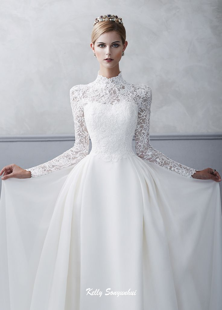 Royal wedding look wedding dress with high neckline and sleeves decorated with cord lace.