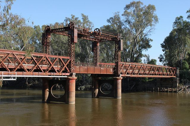 The Tocumwal Rail Bridge over the Murray River. Built in 1895 as a road bridge, it was strengthened when rail arrived in 1908. The NSW side ...