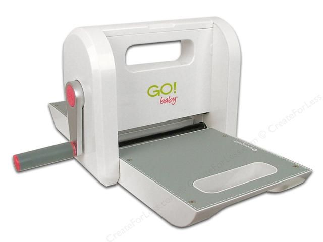 AccuQuilt Go Fabric Cutter and accessories are all parts of this fabric cutting system. Baby- With this cutter you'll have no more backaches, cut fingers, or mistakes from your rotary cutter. Just accurate cuts every time! Place a shape die on the cutter's tray, then a layer of fabric, then the appropriate cutting mat, and then turn the easy roll handle. Multiple cuts in seconds. A smaller version of the first Go Fabric Cutter, and is compatible with over 60% of the original Go dies…