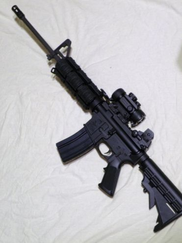 Bushmaster AR-15 with Red Dot ScopeFind our speedloader now!  http://www.amazon.com/shops/raeind