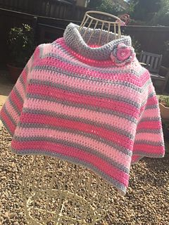 This is my little girl poncho pattern that I have been trying to get finished for nearly a year. I wanted a poncho but something different but not too taxing either. Worked in the round using UK terminology from the neck down, this lovely poncho is easy to make and will look lovely in any colour. It can be made in stripes like mine or plain which ever suits your needs. It can be made longer by adding more rows quite easily. I used just under 200g from 3 balls but you can you 200g in one…