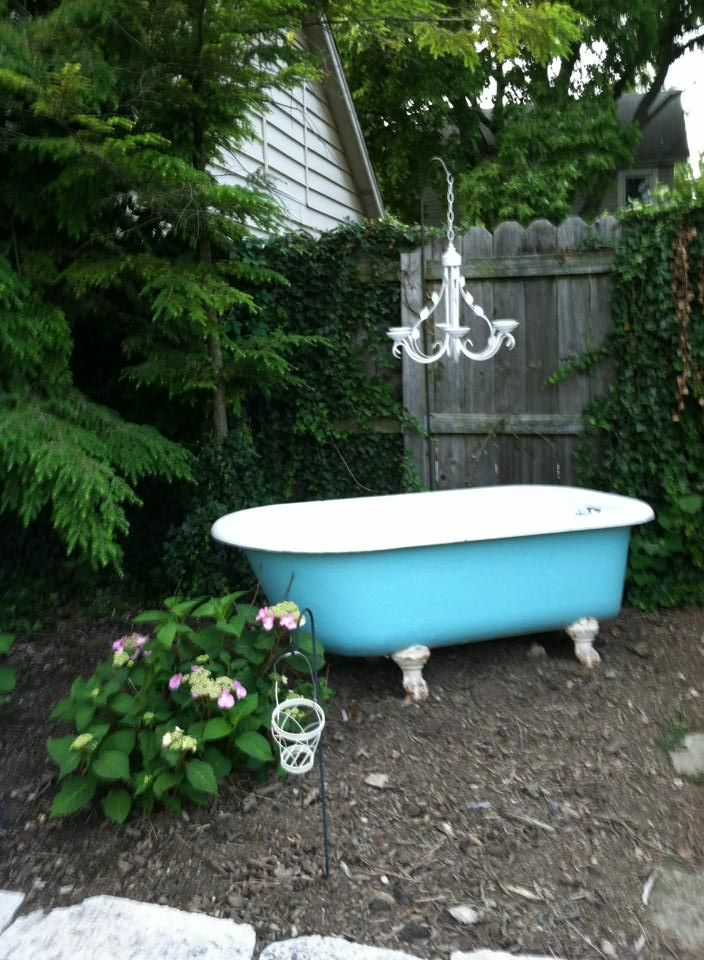 painted claw-foot, cast iron tub adorned with repurposed kitchen chandelier.  SOLD