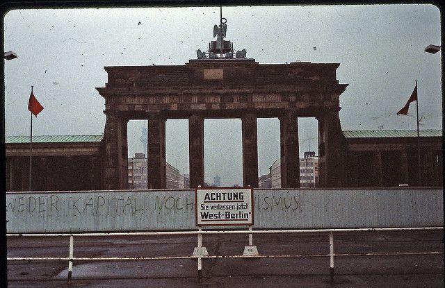 """Beware! You are now leaving West Berlin."" Brandenburger Tor (Brandenburg Gate), Berlin, West Germany, February 1982, photographer unknown."