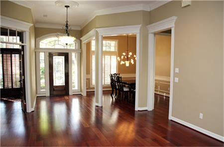 First impressions are important ....neutral colors and Lauzon Brazilian Cherry wood floors flow throughout the Entry, Formal Dining, Living Room, Study and Master Bedroom.
