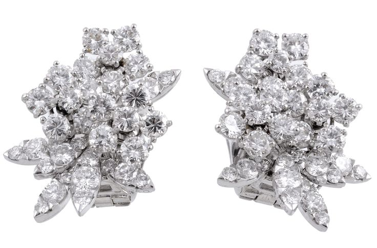 A pair of diamond earrings by Van Cleef & Arpels. To be auctioned in Fine Jewellery | 9 July 2015 [Lot 540]