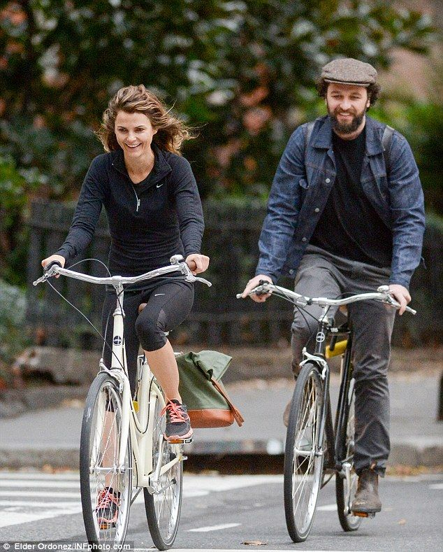 Wheely good time: Matthew Rhys and Keri Russell enjoy a spot of cycling in Brooklyn on Friday