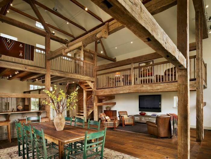 Blanket on rail dinner table and chairs living space Converted barn homes for sale in texas