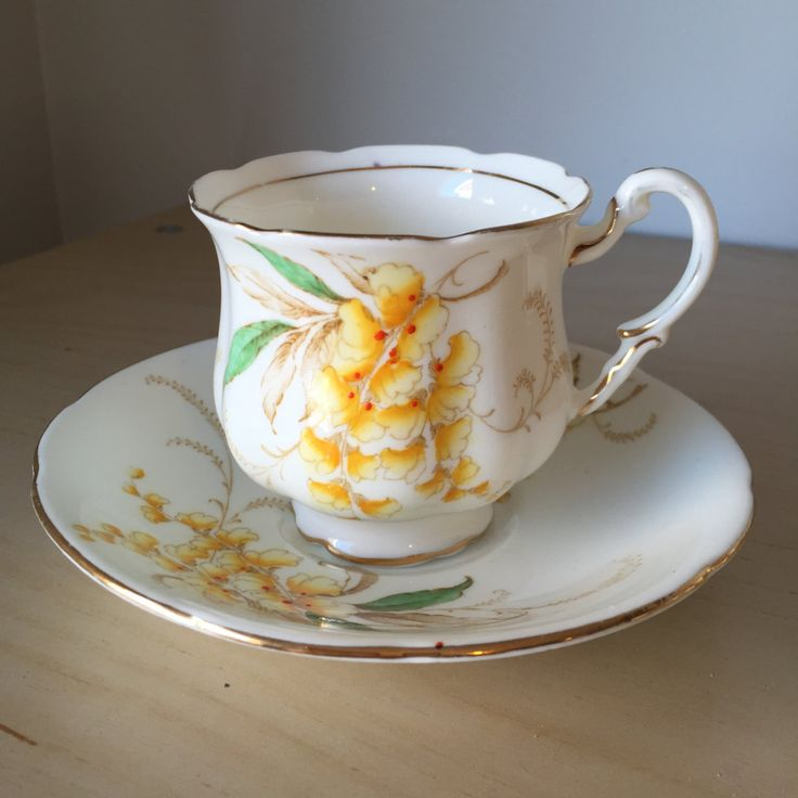 """Paragon """"Wistaria"""" Yellow Flower Vintage Teacup and Saucer, Yellow and Brown Floral Hand Painted Teacup and Saucer, Double Warrant by CupandOwl on Etsy"""