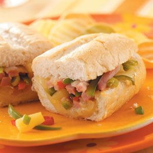 Hawaiian Ham Sandwiches Recipe -I've made these sandwiches many times for family and friends, and they've always been a hit. I often get asked for the recipe. The pineapple is what gives them a Hawaiian flair - we think they're a real treat. I have three grown children and enjoy cooking for them and the grandchildren when they come to visit.