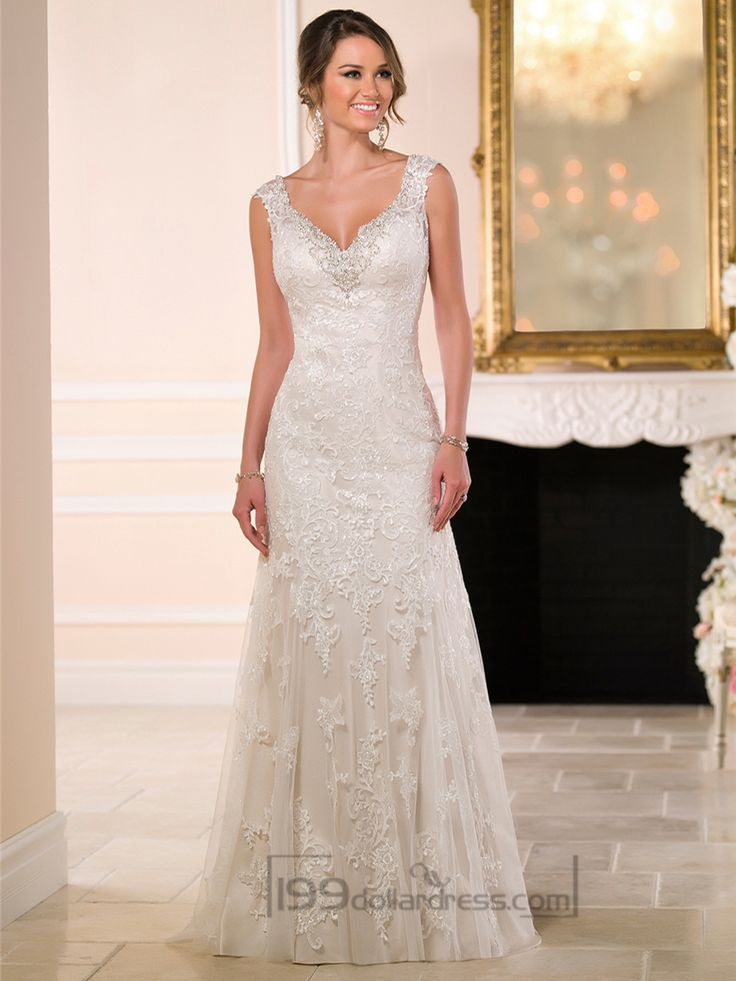 Imagined and handcrafted with stunning detail, artfully layered Diamante embellishments adorn the sweetheart neckline of this sexy column-style wedding dress made from vintage-inspired corded Lace on soft Tulle over Lavish Satin. The back zipper is concealed under sparkling crystal buttons.