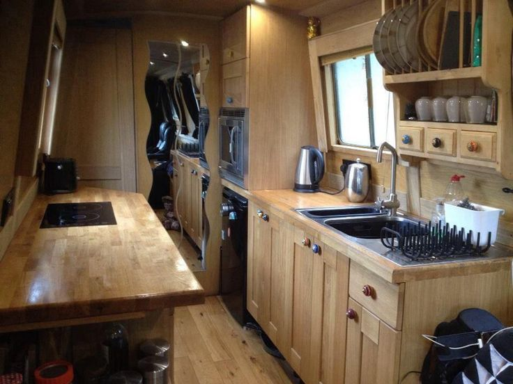 This narrow boat's galley is the perfect home for our traditional oak worktops…