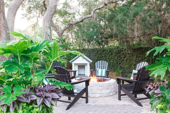 a smart redesign of the backyard creates an outdoor paradise with improved water views and enticing amenities