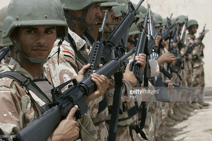 Iraqi soldiers hold their new rifles given by the U.S. forces May 13, at the Taji U.S. military camp in Baghdad, Iraq. U.S. forces have given the Iraqi army 800 pieces of M-16 and M-4 rifles as a part of the U.S. Foreign Military Sales (FMS) program.