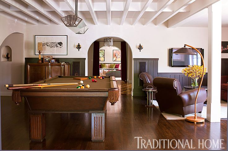 Military green wainscoting, creamy white walls, and dark brown furniture give this neutral game room a masculine feeling. - Photo: Michael Garland / Design: Michael Berman